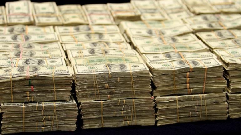 Fajos de billetes del lavado de dinero de los cárteles mexicanos de la droga
